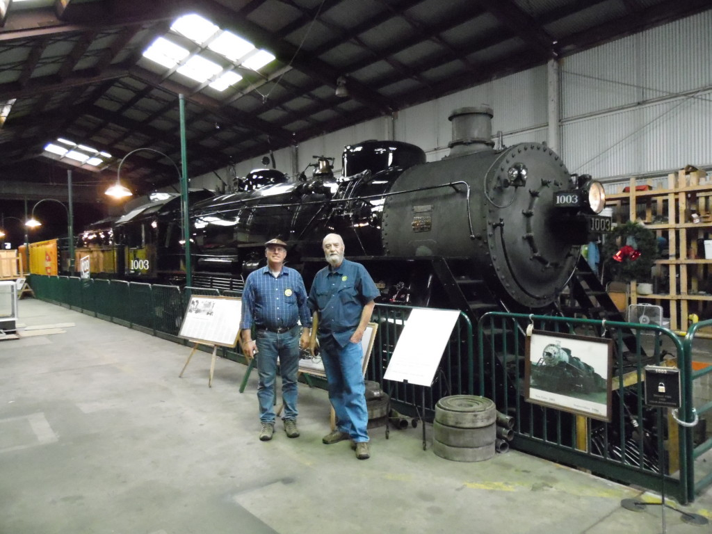 Luke and Mark Mowbray, the Executive Director of the YT next to the restored steam engine