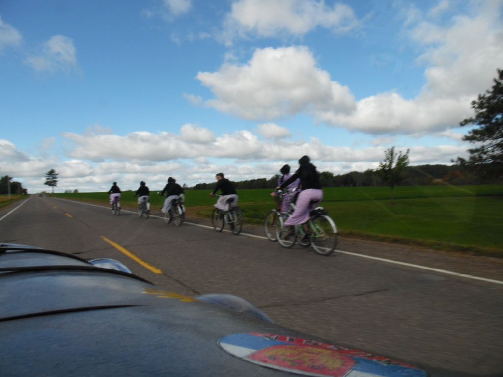 Young Amish girls on bikes ....you can only find this on the backroads!!