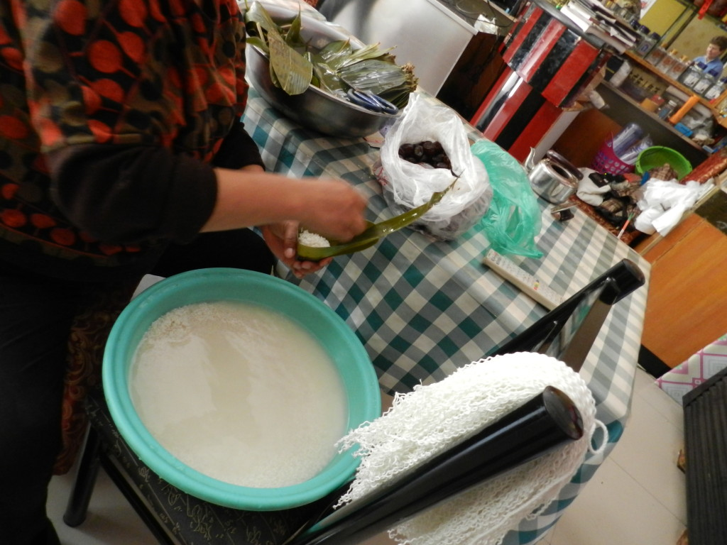 Filling the pouch with rice; notice the string draped on the chair