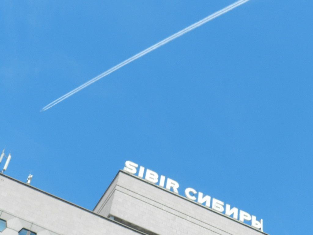 Contrail over hotel in Novosibirsk