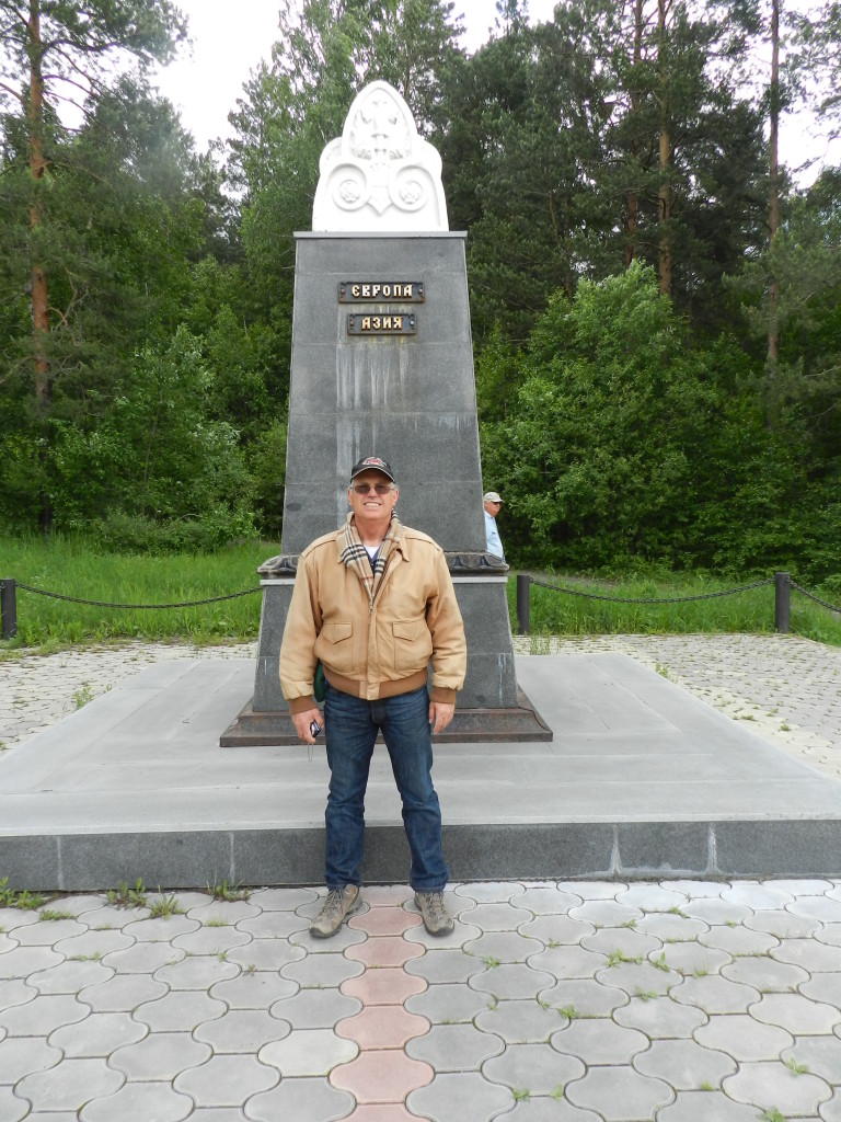Luke with one foot in Europe and one foot in Asia by the remnants of the monument George Schuster engraved