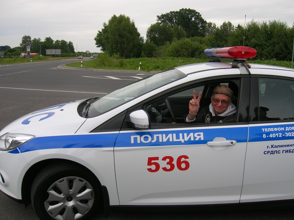 John checks out a Russian traffic police car