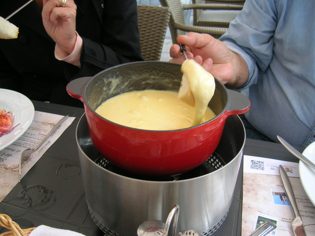 Luke demonstrates the proper way to eat fondue