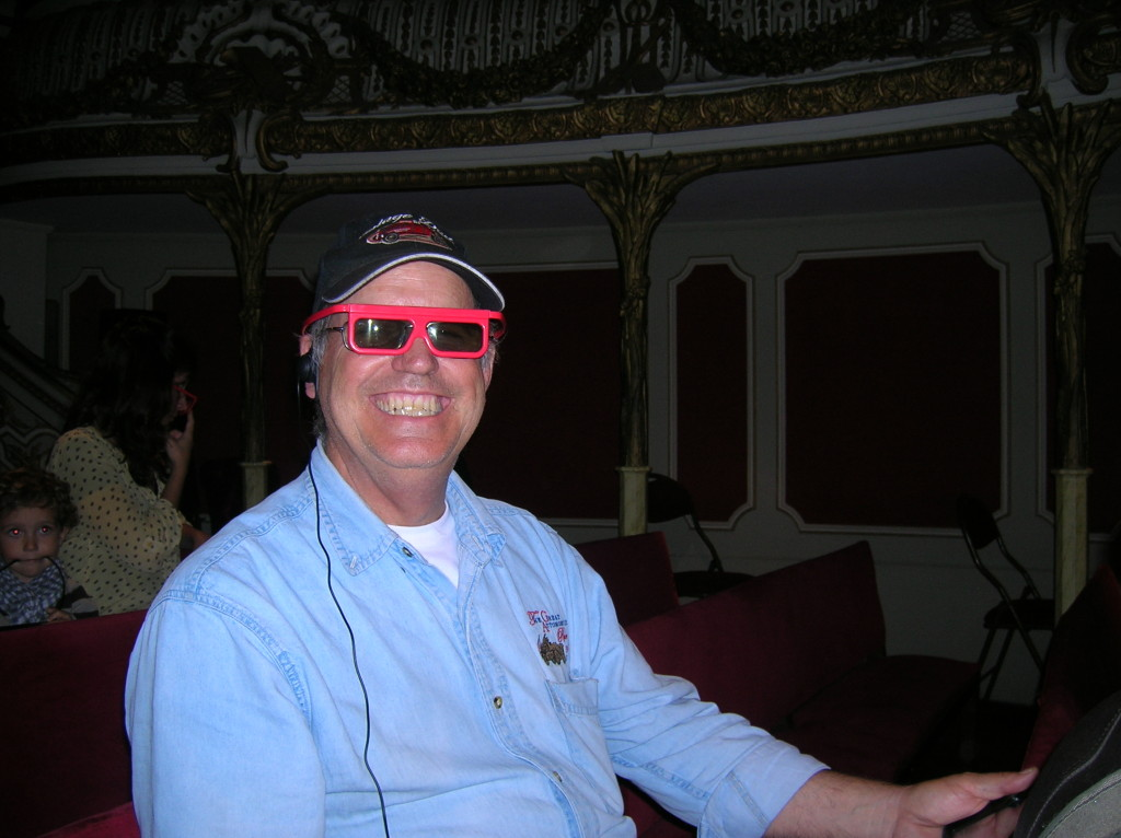Luke demonstrates proper wear of the 3-D movie glasses