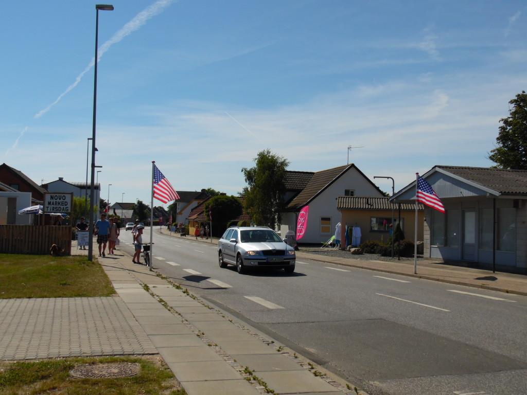 American flags in place for the all American car show
