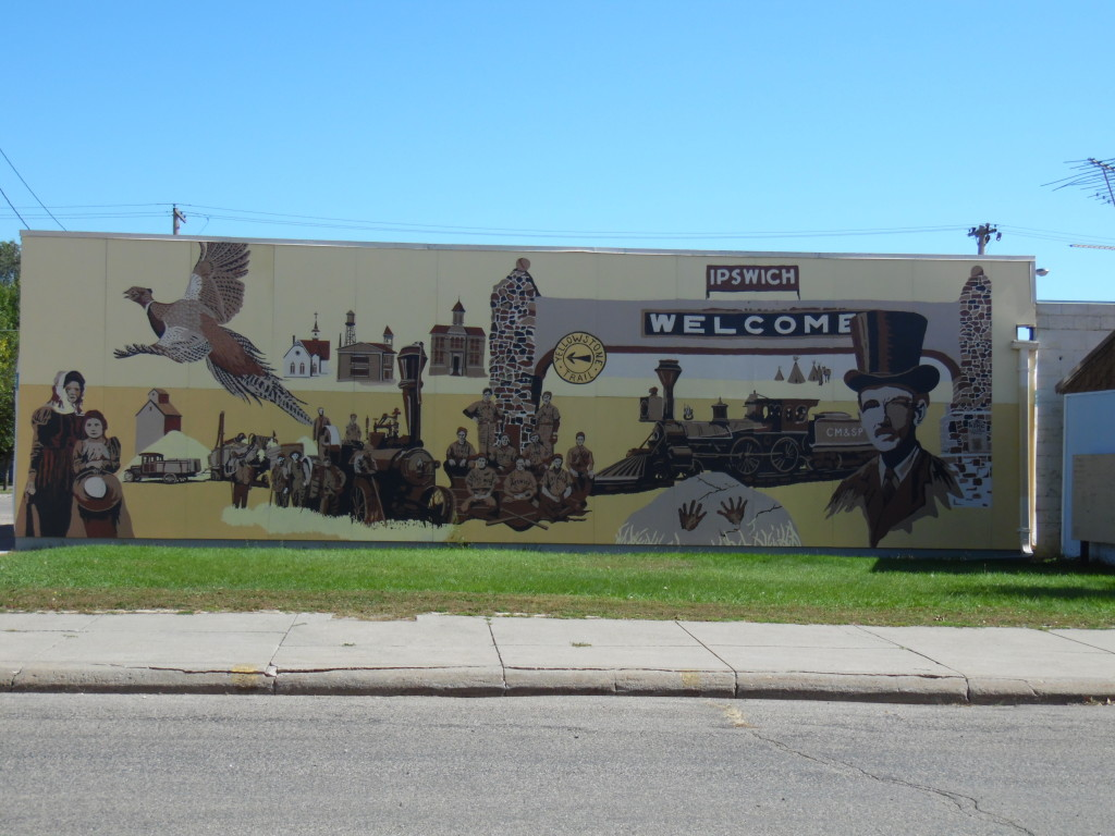 YT mural on a Main St building