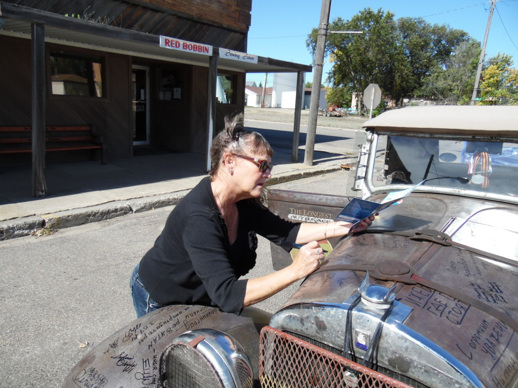 Glorya signing the car...we're fast running out of room for signing