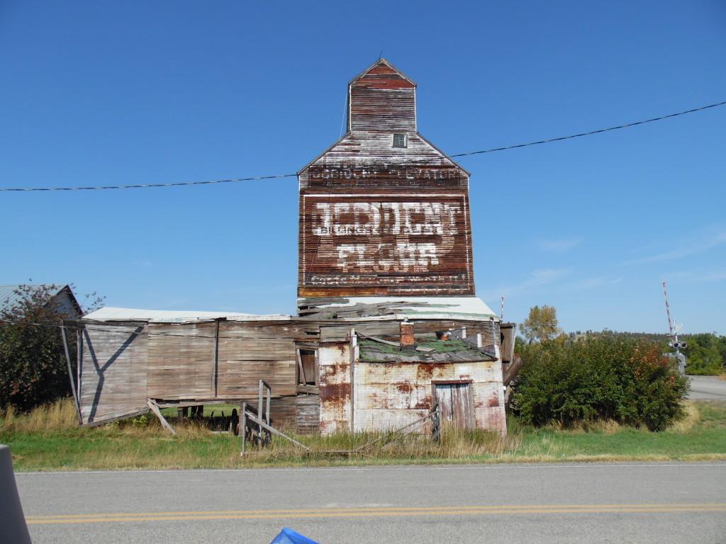 Abandoned elevator next to the railroad tracks...I like the signage